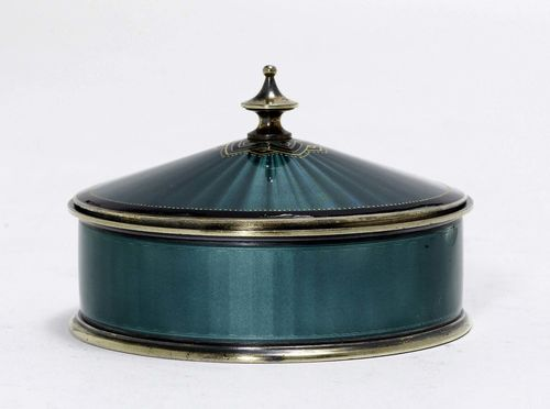 ENAMEL BOX WITH COVER,Norway 20th century. Round, enamelled in turquoise all around over engine-turned background. Cone-shaped knob. D 9 cm, 170 g.