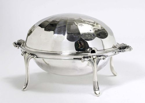 VEGETABLE POT WITH LID,silver-plated. Oval shape on four retracted legs. With a smooth and open-worked insert. Facetted lid, handles on both sides. H 13 and 23 cm.