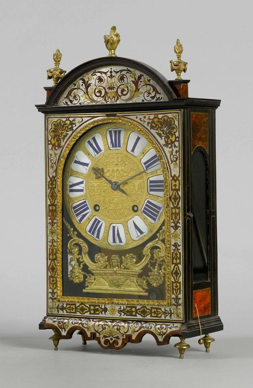 MANTEL CLOCK WITH BOULLE MARQUETRY,Louis XIV, the dial signed MICHELIN À DIJON, the movement signed. GRIBELIN À PARIS. Rectangular case with Boulle marquetry in red tortoiseshell, brass and tin, with trailing flowers and leaves. Bronze dial with white enamel cartouches. Movement with verge escapement striking the 1/2-hour on 3 bells. Repeater. H 55 cm.