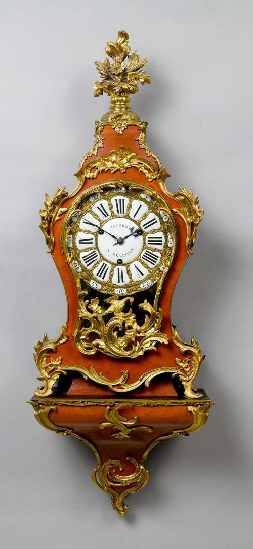 PAINTED CLOCK ON PLINTH,Louis XV, France, 18th century. The movement and dial signed JOFFROY À BESANCON. Curved, wooden case, painted red and with opulent bronze applications designed as flowers, leaves, rocailles and a bird. Bronze dial with white enamel cartouches. Movement with verge escapement string the 3/4-bells. H 123 cm. Painting, later. Bronze, in part later.