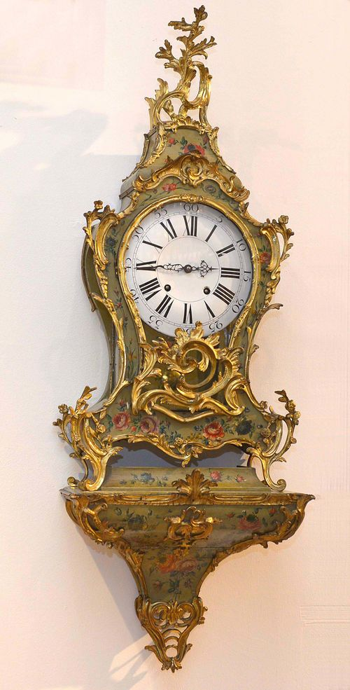 "PAINTED CLOCK ON PLINTH,Louis XV, France, 18th century. Curved wooden case painted with flowers on a green ground. Opulent bronze mounts designed as leaves, volutes and rocailles. White enamel dial ""en cuvette"". Movement with verge escapement striking the 1/2-hour on bell. H 133 cm. Bronze, later gilt. Requires some restoration."