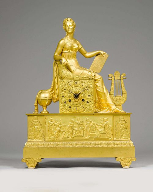 MANTEL CLOCK,Empire, Paris. Gilt bronze. Rectangular with a seated female figure, probably the Allegory of Astronomy. On  a rectangular plinth with volute feet. Bronze dial. Parisian movement striking the 1/2-hour on bell. H 50 cm. Mount of the movement, altered. Provenance: - from a Zurich private collection.