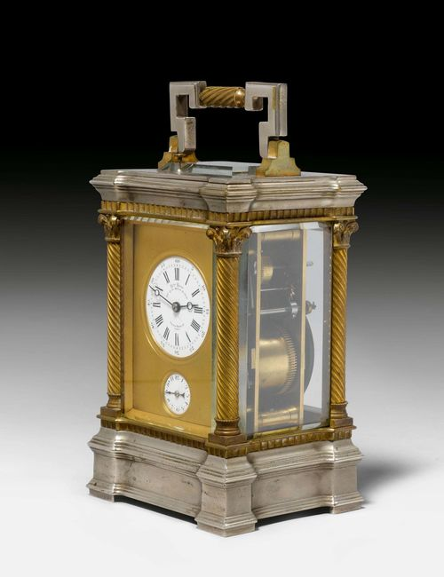 FROM THE DE AMODIO COLLECTION: TRAVEL CLOCK WITH ALARM,France, middle of the 19th century. The dial signed: CH(AR)LES UDIN H(ORLO)GER DE LA MARINE DE L'ETAT PALAIS ROYALE 52, PARIS. Metal, silver-plated and parcel-gilt. Glazed all around. White enamel dial, alarm dial below. Movement with main spring, striking the 1/2-hour on gong. Repetition on demand. Alarm requires servicing. H 19 cm. With leather case. Provenance: - from the collection of the Marquis and the Marquise de Amodio y Moya.