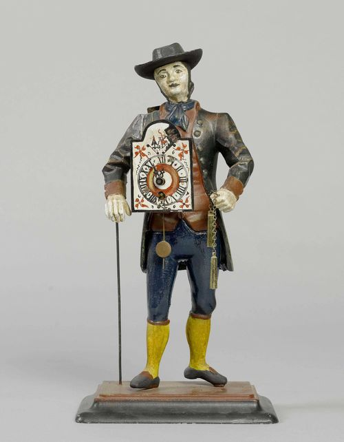FIGURE CLOCK,Black Forest. Cast iron, painted. Movement with spring winding. H 38 cm.