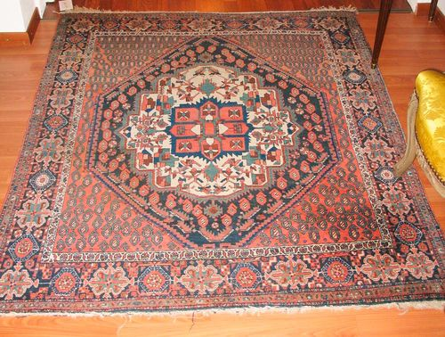 AFSHAR old.White central medallion on a rust coloured ground, the entire carpet is finely patterned with boteh motifs and stylized plants, black border, good condition, 160x130 cm.