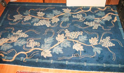 CHINA antique. Blue central field, decorated with two vine tendrils in beige and light blue, good condition, 200x125 cm.