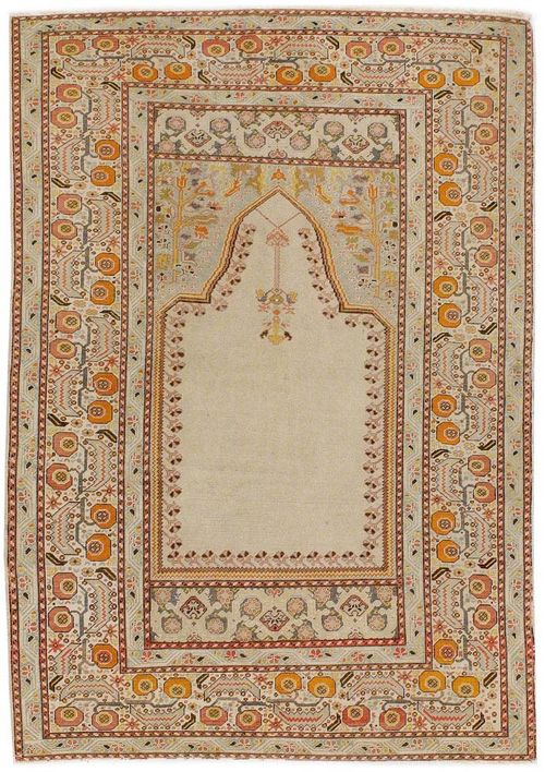 GHIORDES antique.Beige mihrab with light blue spandrels, broad border in white, decorated with trailing flowers, signs of wear, 180x130 cm.