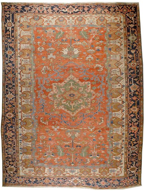 HERIZ SERAPI antique.Green central medallion on a red and white ground, geometrically patterned with stylized plant motifs in attractive colours, blue border, good condition, 416x300 cm.
