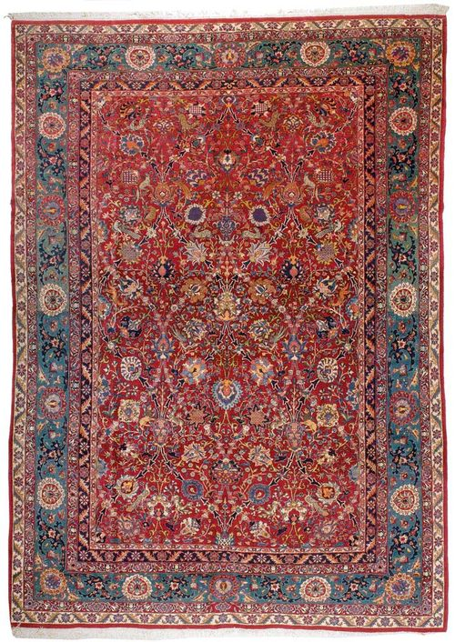 ISFAHAN old.Violet central field, patterned throughout with colourful trailing flowers and animals, green border, slight wear, 305x215 cm.