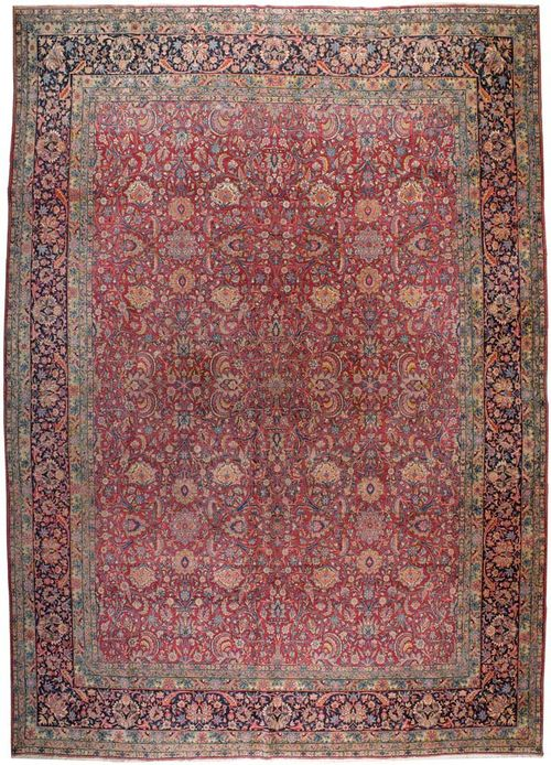 KIRMAN LAVER antique.Dusky pink ground, finely patterned with trailing flowers and palmettes in attractive colours, dark border, signs of wear, 444x296 cm.