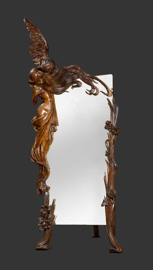 ANONYMOUS MIRROR, circa 1900 Carved pine with brown patina. Young woman kissed by cupid. H. 250 cm. L. 100 cm.