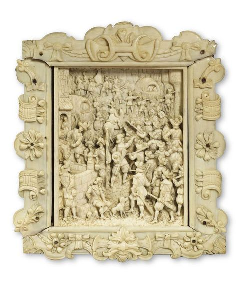 RENAISSANCE IVORY PLAQUE, North German or Flemish, 17th century. Carved with soldiers, with city view in the background.  H 9 cm, W. 7 cm. Lit.: C. Scherer, Die Braunschweiger Elfenbeinsammlung, Leipzig 1931; No. 234.
