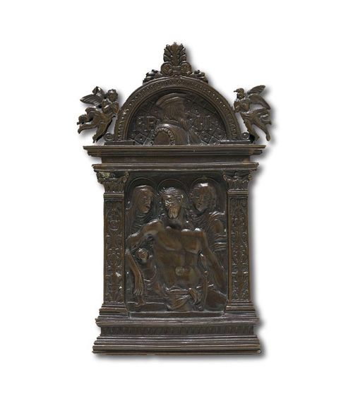 "BRONZEPLAQUE ""PIETA"", Renaissance, in the style of  MODERNO (Pseudonym of a goldsmith active in Italy end of 15th/beginning of 16th century), probably Venice circa 1600. Patinated bronze. Tabernacle-shaped frame with portrait of Ferdinand II , H 15.4 cm; W. 9.5 cm. Lit.: ""Les Arts"", August 1908, ill. II. E.F. Bange, Die italienischen Bronzen der Renaissance und des Baroque, Berlin 1922; p. 63."