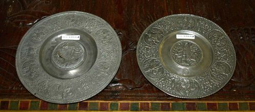 PAIR OF ELECTORAL PLATES, after 17th century designs. Nuremberg Master, probably 19th century. Pewter. With portraits of the Emperor within grotesques and arabesques. Partly damaged. D 20 and 18 cm.