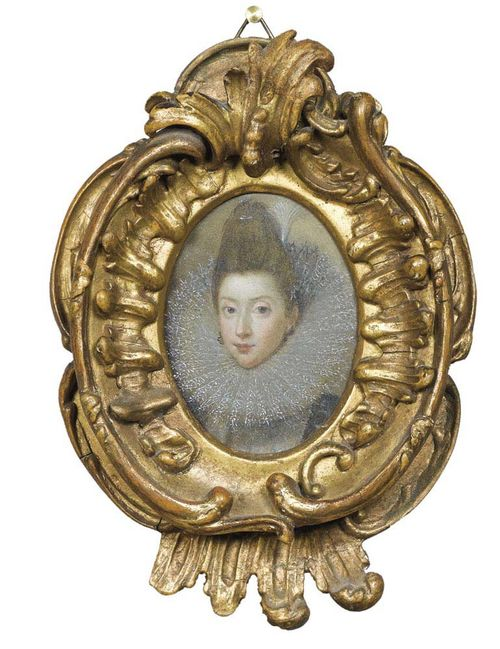 England circa 1600. Oil on copper. Portrait of Katherine de Rochefort, wife of Sir Thomas De La Feld, the oldest relative of Wilhelm Lord Fitzwarine.  6.3x4.8 cm. In oval carved wooden frame with foliate decoration. .