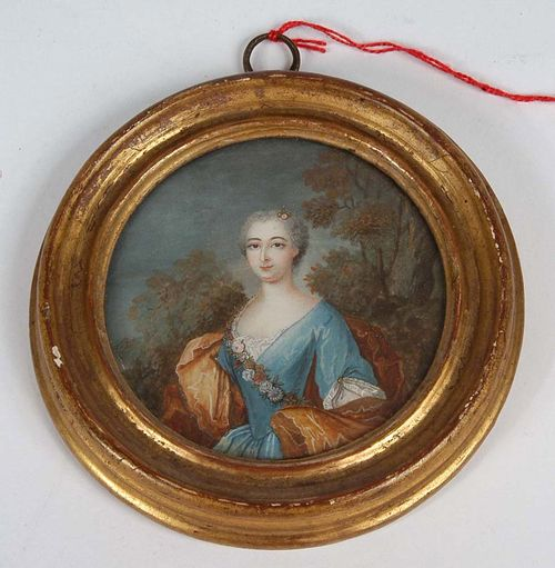 France. 18th century. Painting on vellum. Oval half portrait of young woman of the court of Louis XV, set against landscape background. Ø 7.3 cm.