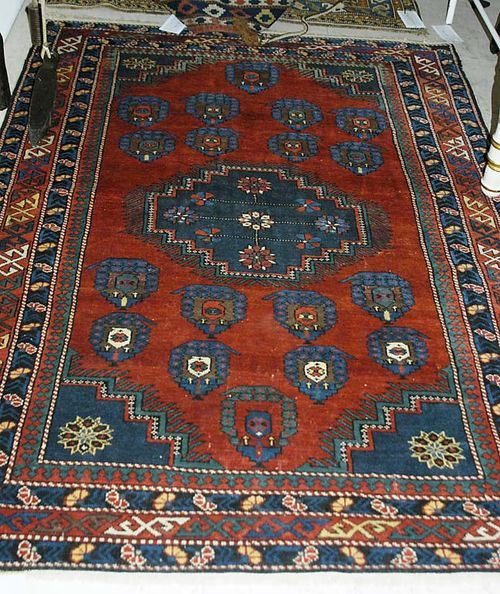 SHIRVAN old. Red ground with central medallion and boteh motifs in blue and red, with blue border. Good condition, 175x120 cm.