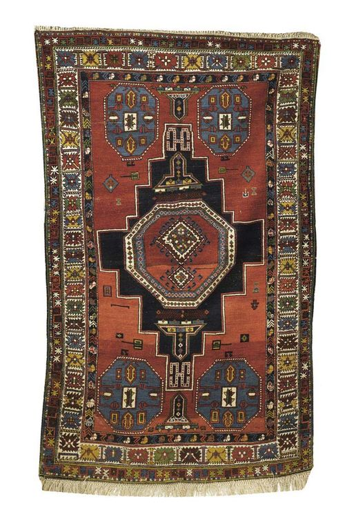 SHIRVAN antique. Rust red ground with stepped black-red central medallion and blue octagons. Brightly coloured triple stepped border. Some wear. 220x135 cm.