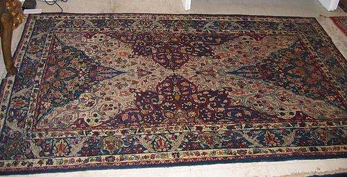 TEHERAN, old. Blue and white central field, patterned with trailing flowers and palmettes, blue floral border, good condition, 209x134 cm.