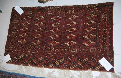 TEKKE CHOWAL antique. Central field with 5 rows of guls. Slight wear.  67x117 cm.