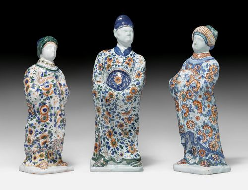 THREE FIGURES OF A CHINESE 'BONZ' AND TWO CHINESE WOMEN,