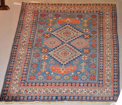 DERBEND old.With a blue ground, geometric patterning and a white border. Some light wear, 107x203 cm.