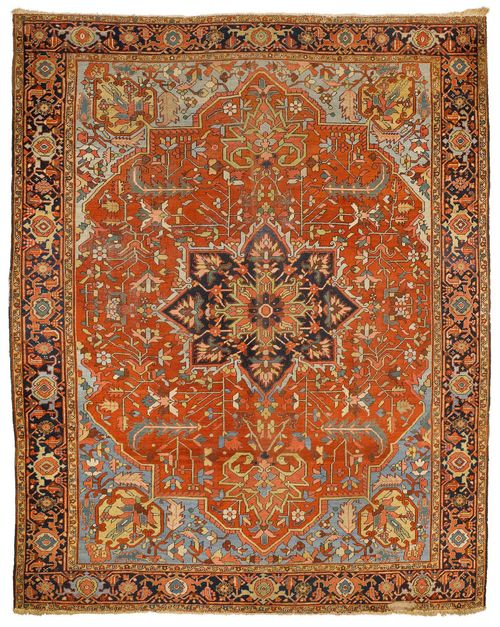 HERIZ SERAPI antique. With a black central medallion on a red ground with light blue corner motifs, patterned with stylised plant motifs in harmonious colours and with a black border. Some wear, 295x365 cm.