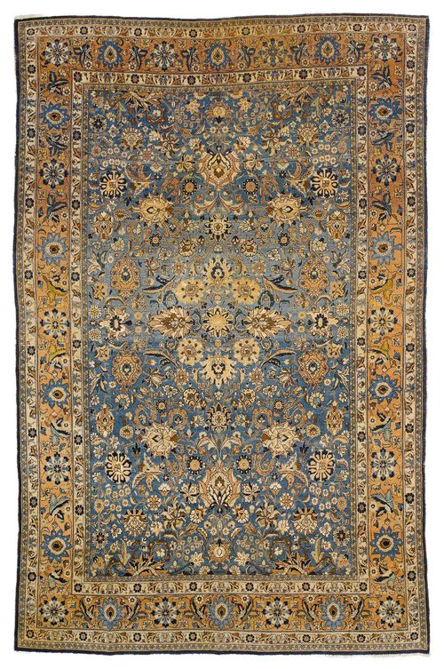 KESHAN antique. The blue central field is patterned with trailing flowers and palmettes in beige and black, with a beige border. Some wear, 220x345 cm.