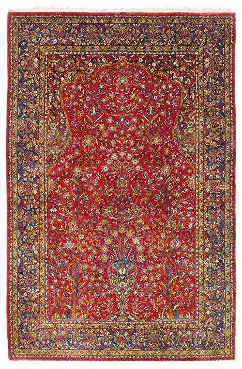 KESHAN SILK antique. With a dark red Mihrab with blue spandrels, finely patterned with floral motifs in harmonious colours. Blue border. Good condition, 136x205 cm.