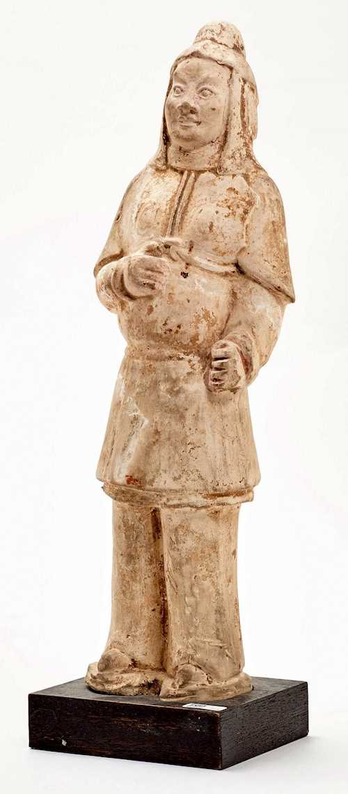 A CLAY GUARDIAN FIGURE.
