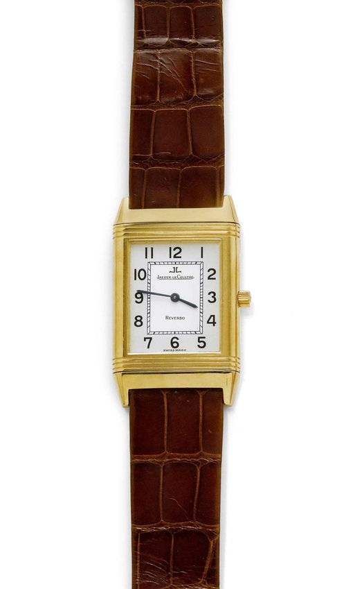 LADY'S WRISTWATCH, JAEGER LE COULTRE, REVERSO. Yellow gold 750. Ref. 250.1.86, new 250.140.862. Rectangular case No. 1828902 with ribbed lunette. Two-tone dial with black Arabic numerals and blued hands. Hand winder, Cal. 846/1. Brown leather band with Jaeger gold clasp. D ca. 39 x 24 mm. With case, warranty, and copy of the insurance estimate, August 2004.