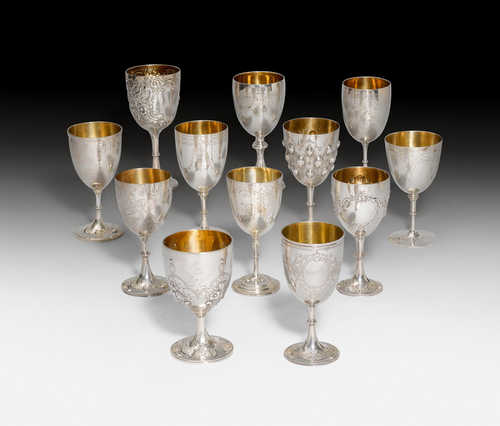 SET OF 12 FOOTED BEAKERS,