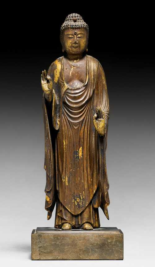 A SMALL LACQUER GILT WOOD FIGURE OF A STANDING AMIDA NYORAI.
