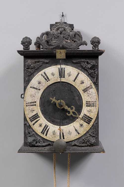 CLOCK WITH WOODEN COGWHEELS AND FRONT PENDULUM,