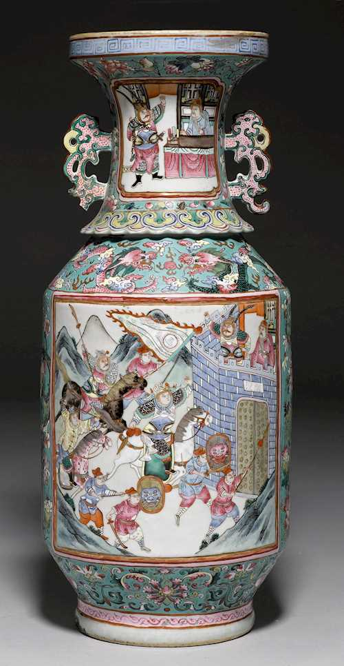 A FAMILLE ROSE VASE WITH CARTOUCHES SHOWING COURTLY SCENES AND DRAGONS AMONG CLOUDS.