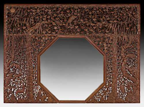 A MAGNIFICENT CAOHUALI IMPERIAL PALACE PARTITION WITH OCTAGONAL DOORWAY CARVED IN OPEN WORK.