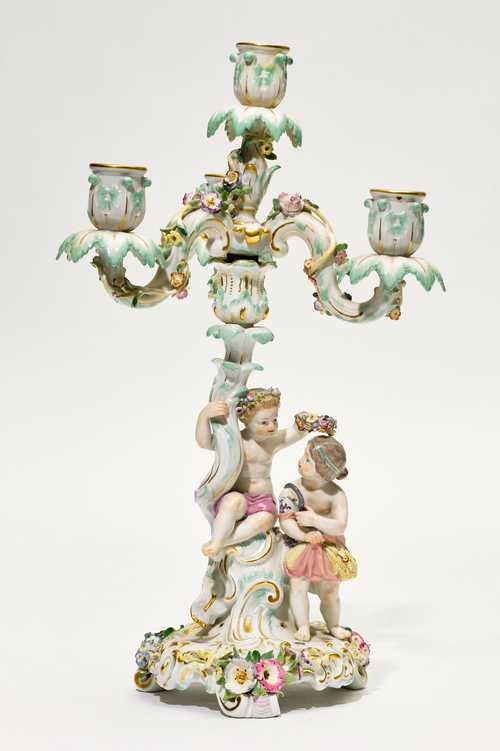 A PORCELAIN CANDELABRUM WITH FIGURES OF CHILDREN AS AN ALLEGORY OF SUMMER,