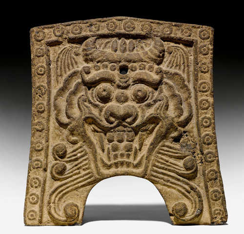 A DEMON-MASK POTTERY TILE.