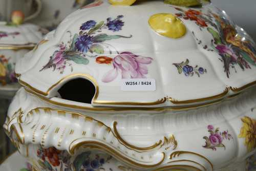 AN EXTENSIVE 'ROCOCO FORM' DINNER SERVICE WITH FLORAL DECORATION AND GOLD BORDERS (90 pieces),