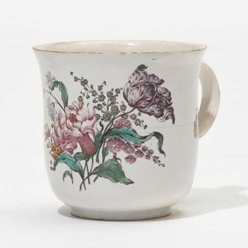 A FAIENCE CUP WITH FLOWER BOUQUETS,