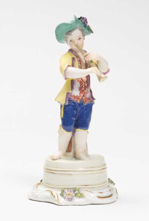A FIGURE OF A FLUTE PLAYING BOY,