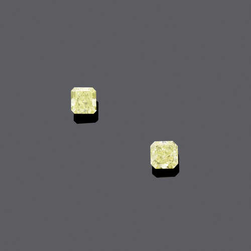 PAIR OF FANCY INTENSE YELLOW DIAMONDS.