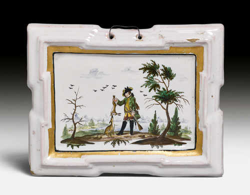 A FAYENCE PLAQUE WITH HARE HUNT,