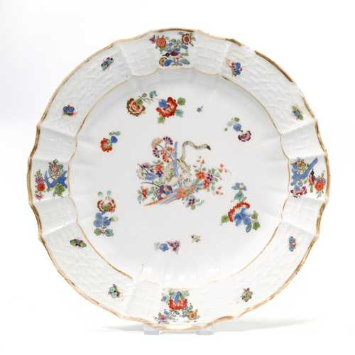 "2 PLATES WITH EAST ASIAN DECORATION ""YELLOW LION"","