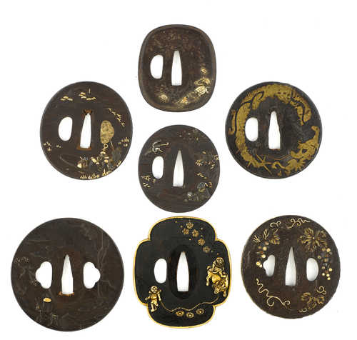 SEVEN TSUBA WITH GOLD DAMASCENED DETAILS.