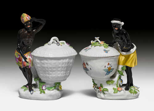 TWO MOORS WITH CONFECTIONARY BOWLS,