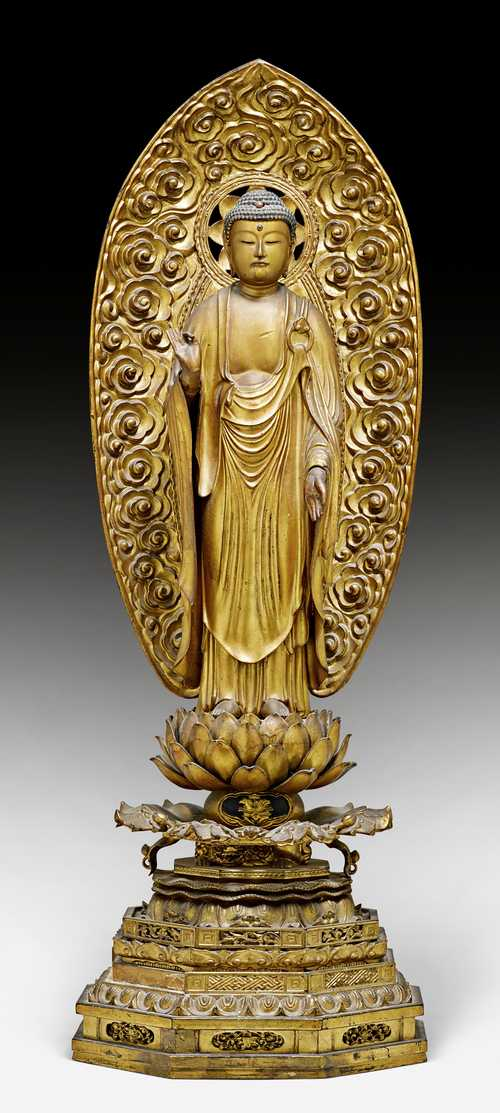 A GOLD LACQUERED WOOD FIGURE OF THE STANDING AMIDA NYORAI.