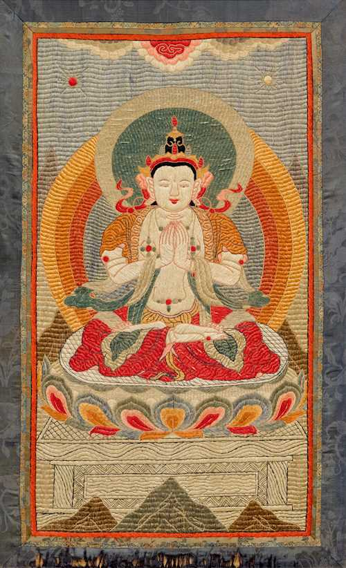 A SILK EMBROIDERED THANGKA OF AVALOKITESHVARA.