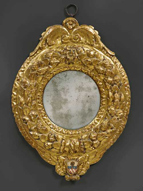 CARVED AND GILT FRAME AS A MIRROR,