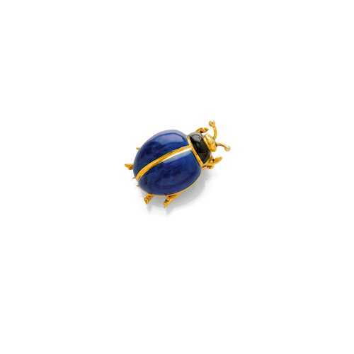 ENAMEL AND GOLD CLIP BROOCH.